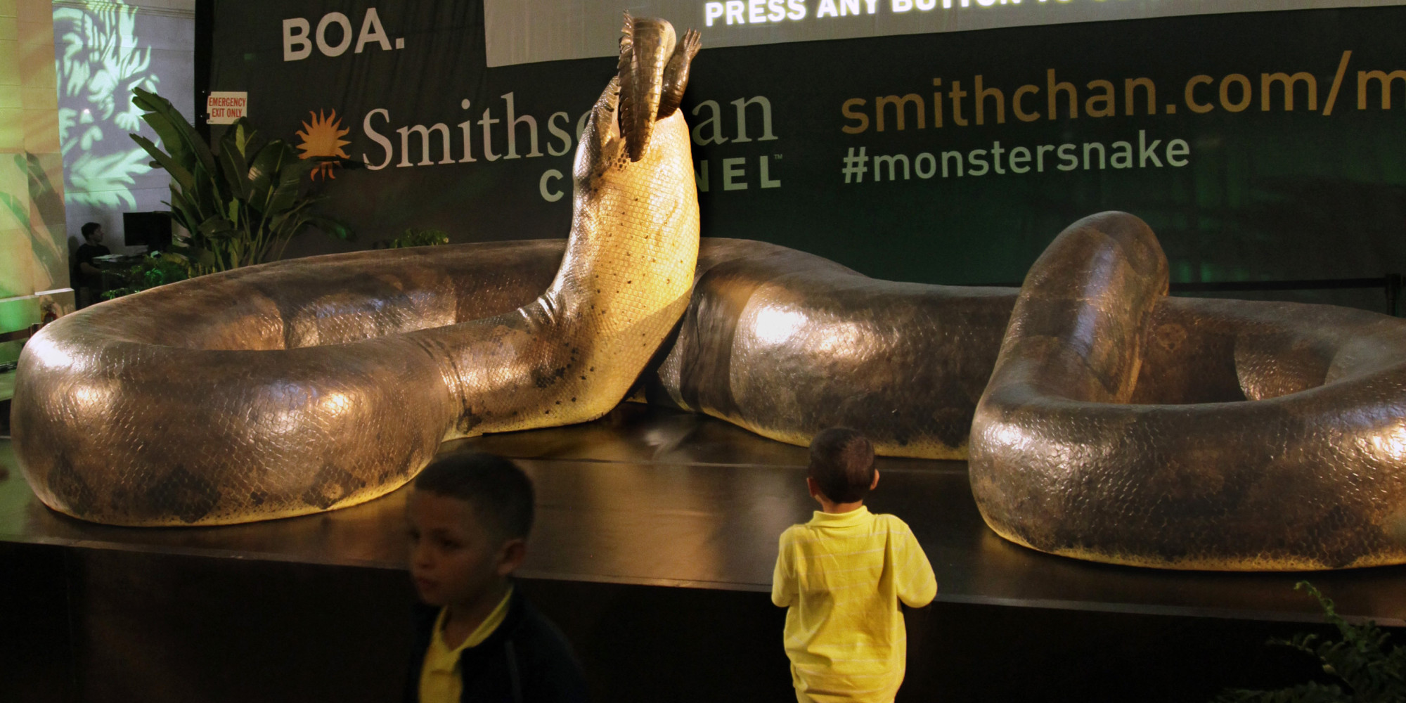 "FILE - In this March 23, 2012 file photo, a full-scale replica of the pre-historic snake ""Titanoboa"" swallowing a crocodile, is previewed at Grand Central Station in New York, during a promotion for its exhibition at the Smithsonian's National Museum of Natural History in Washington. (AP Photo/Bebeto Matthews, File)"