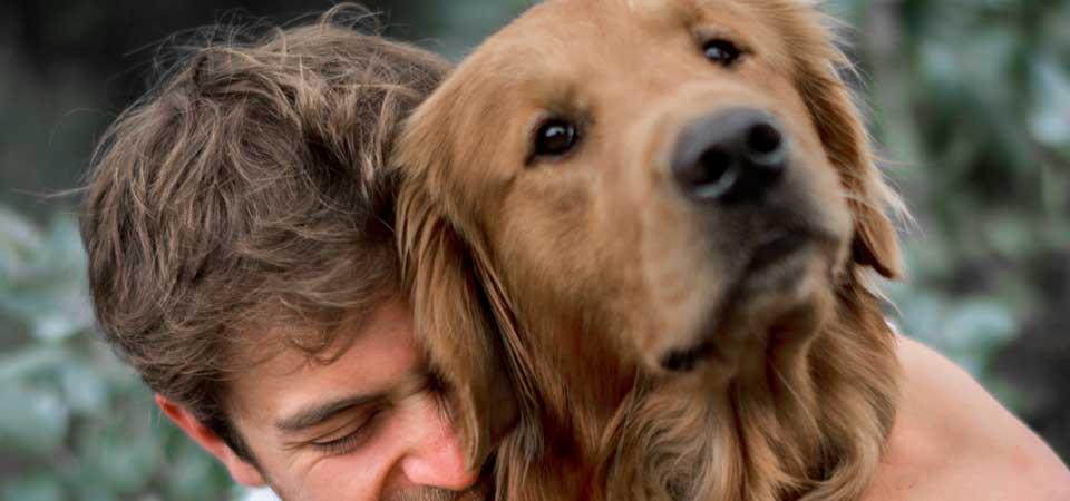 Loving man hugging his dog